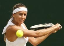Gisela Dulko looks to hit a slice shot.jpg
