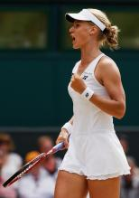 Elena Dementieva celebrates a point during Wimbledon.jpg