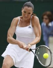 Jelena Jankovic hits a two handed backhand during Wimbledon.jpg