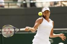 Ana Ivanovic hits a forehand during Wimbledon 2009.jpg