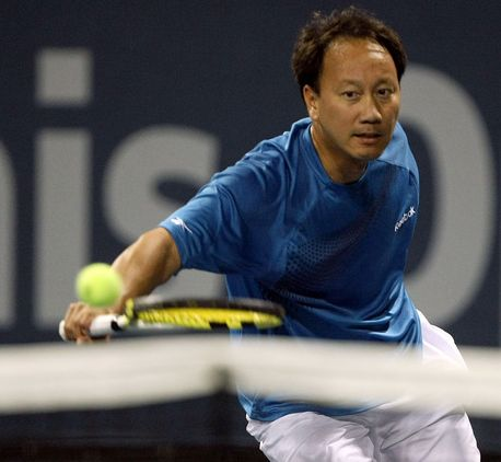 Michael Chang hits a backhand slice during his Legends match in LA.JPG