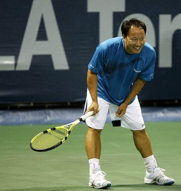 Michael Chang smiles during his Legends Match against Jim Courier 2009.JPG