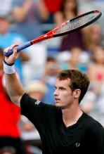 Andy Murry raises his racket to the crowd.JPG