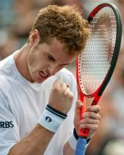 Andy Murray celebrates while holding his Head Youtek racquet.JPG