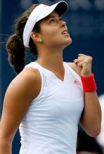 Ana Ivanovic celebrates a point and looks to the sky.JPG