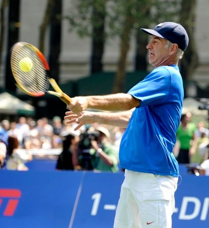 John McEnroe hits a forehand at the 2009 US OPEN experience.JPG