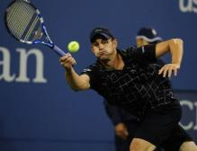 Andy Roddick hits a reverse forehand on the run.JPG