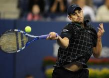 Andy Roddick hits a driving forehand.JPG