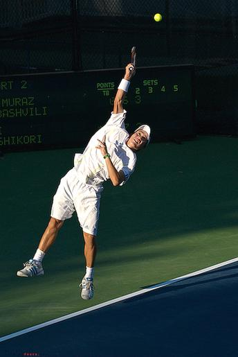 Kei Nishikori goes for a serve.jpg