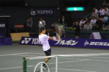 Kei Nishikori hits a volley.jpg