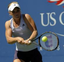 Melanie Oudin hits a two handed backhand with her Wilson Racket.JPG