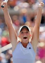 Melanie Oudin is elated after winning.JPG