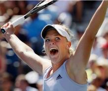 Melanie Oudin raises her arms in celebration.JPG