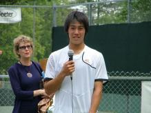 Kei Nishikori holds a microphone in post-match interview.jpg