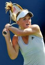 Melanie Oudin follows through on a backhand.JPG