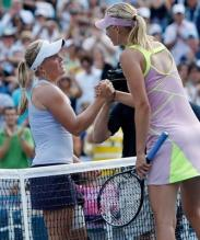 Melanie Oudin shakes Maria Sharapova's hand after defeating her at the US Open 2009.JPG
