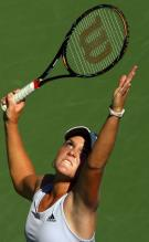 Melanie Oudin tosses the ball on her serve.JPG