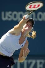 Melanie Oudin flat serve follow through.JPG