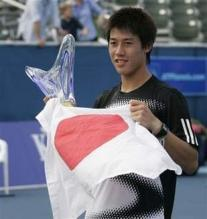 Kei Nishikori holds Japan flag and trophy after winning Delray Beach Tennis Tournament.jpg