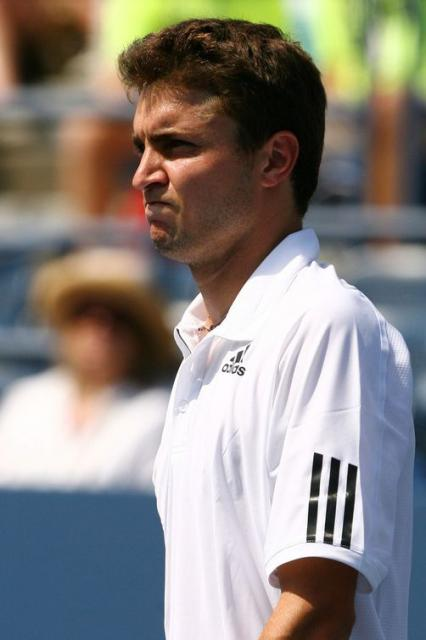 Gilles Simon looks on.JPG