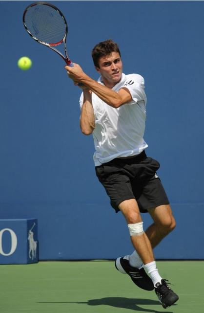 Gilles Simon has an interesting grip on his two handed backhand.JPG