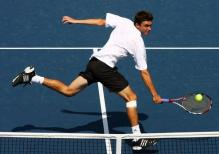 Gilles Simon hits a backhand volley.JPG