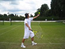 Kei Nishikori prepares to serve on Wimbleton practice court.jpg