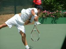 Kei Nishikori serve follow through.jpg