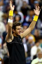 Del Potro raises both arms in celebration.JPG