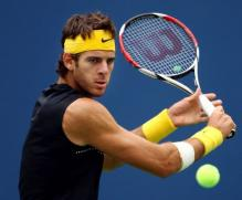 Juan Martin Del Potro goes for a backhand dropshot.JPG