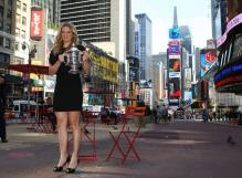 Kim Clijsters poses with her US Open 2009 trophy at Times Square NYC.JPG