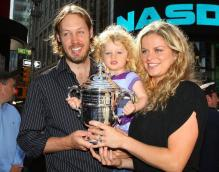 Kim Clijsters with her daughter and husband at Times Square New York.JPG