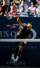 Del Potro jump serve follow through.JPG
