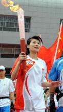 Li Na carries the Olympic torch.JPG