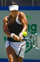 Li Na goes low to hit a two handed backhand.JPG