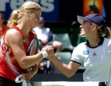 Kim Clijsters shakes hands with Justine Henin back in 2002.JPG