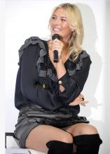 Maria Sharapova smiles as she holds the microphone in Japan.JPG