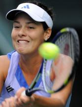 Ana Ivanovic two handed backhand at contact close up.JPG