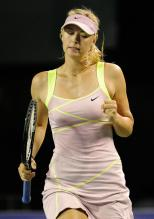 Maria Sharapova clenches her fist in celebration in Tokyo.JPG