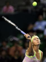 Maria Sharapova hits an easy overhead volley.JPG