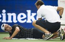 Andy Roddick gets worked on by a trainer.JPG