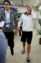 Andy Roddick in white jacket and shorts in Shanghai.JPG