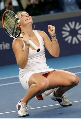 Timea Bacsinszky bends down and looks to the sky in celebration.JPG