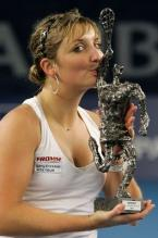 Timea Bacsinszky kisses her Luxembourg Open trophy 2009.JPG