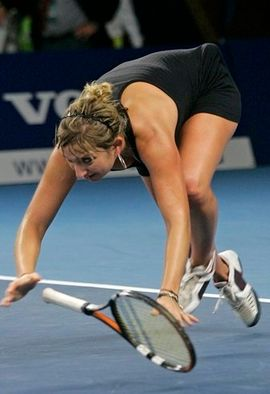Timea Bacsinszky falls to the ground in a black tennis dress.JPG