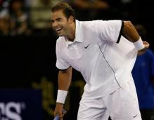 Pete Sampras has a laugh and plays around during his exhibition match against Agassi in 2009.JPG