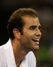 Pete Sampras laughs during a point vs Agassi in 2009.JPG