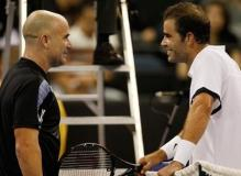 Pete Sampras talks to Andre Agassi across the net.JPG