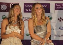 Victoria Azarenka has a laugh with Caroline Wozniacki.JPG