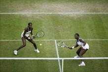 Williams sisters playing tennis doubles.jpg